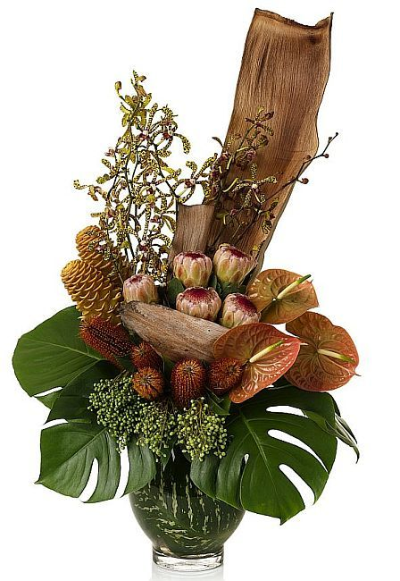 Native Australian Banksia, S. A Protea and Palm Husk taking centre stage in this rugged floral arrangement. Great flowers for men!