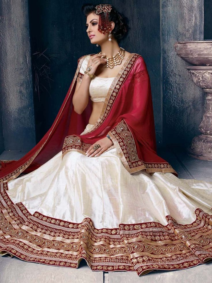 Magnificent off white color #Silk #Lehenga is garnished with #Zari, #Kundan, #Stones work. Item code: GKRI1203A http://www.bharatplaza.com/new-arrivals/lehengas.html