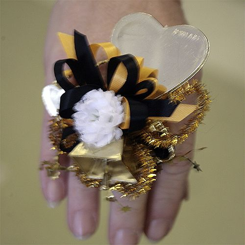 This is so much better than a huge homecoming mum on your chest .... a big homecoming mum on your finger!