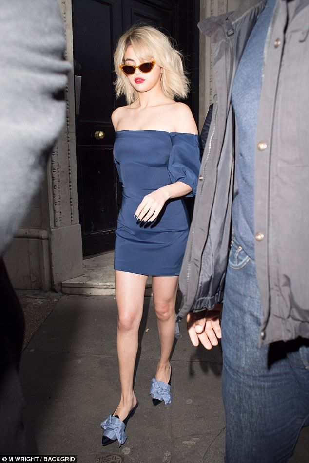 Skintight: After appearing on London radio station, Kiss FM, Selena made a more scanty exit as she sashayed out of the building in the bardot mini dress