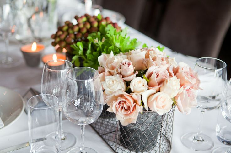 Floral centrepiece in rustic wire basket. Styled by Greenstone Events.