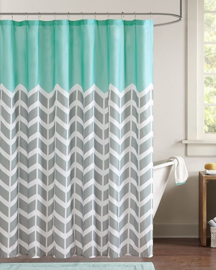 Our Chevron Aqua Shower Curtain makes any bathroom fun and inviting. A gray and white chevron print runs along the shower curtain broken up by white vertical stripes. The rich pop of teal at the top p