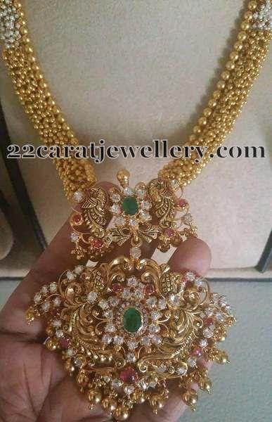 gold-swirls-necklace-peacock-pendant