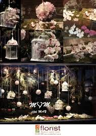 This is an example of a florists window display for mothers day. They have used pretty bird cages and pastel colours.