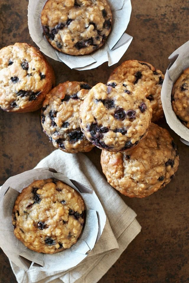 These soft and tender blueberry oat Greek yogurt muffins are made with NO butter or oil! Naturally sweetened and delicious!