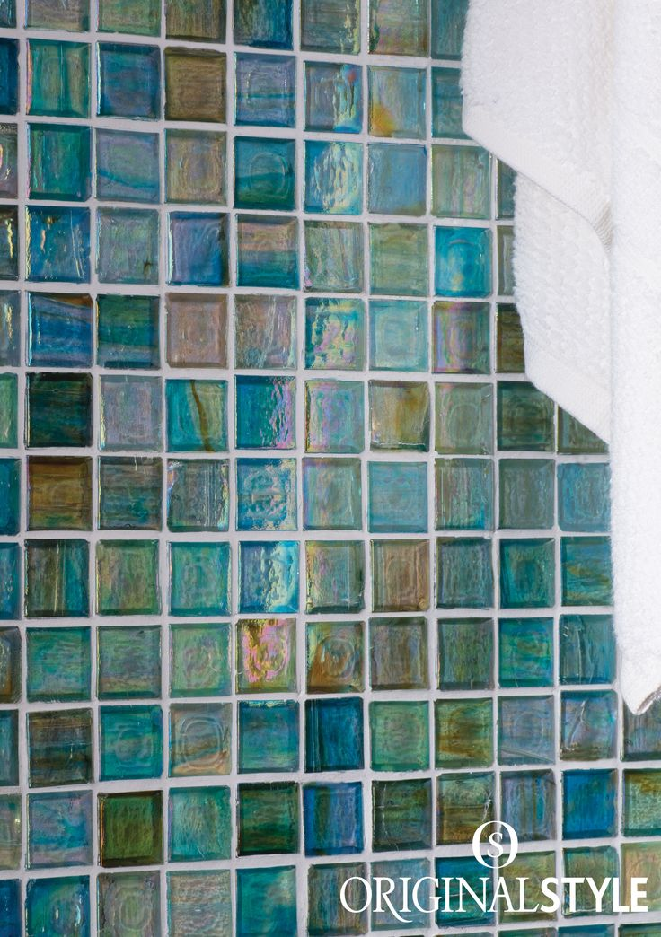 These clear translucent mosaics are faced with film as the standard mesh backing would show through when installed. Their iridescent adds luxury to a bathroom.
