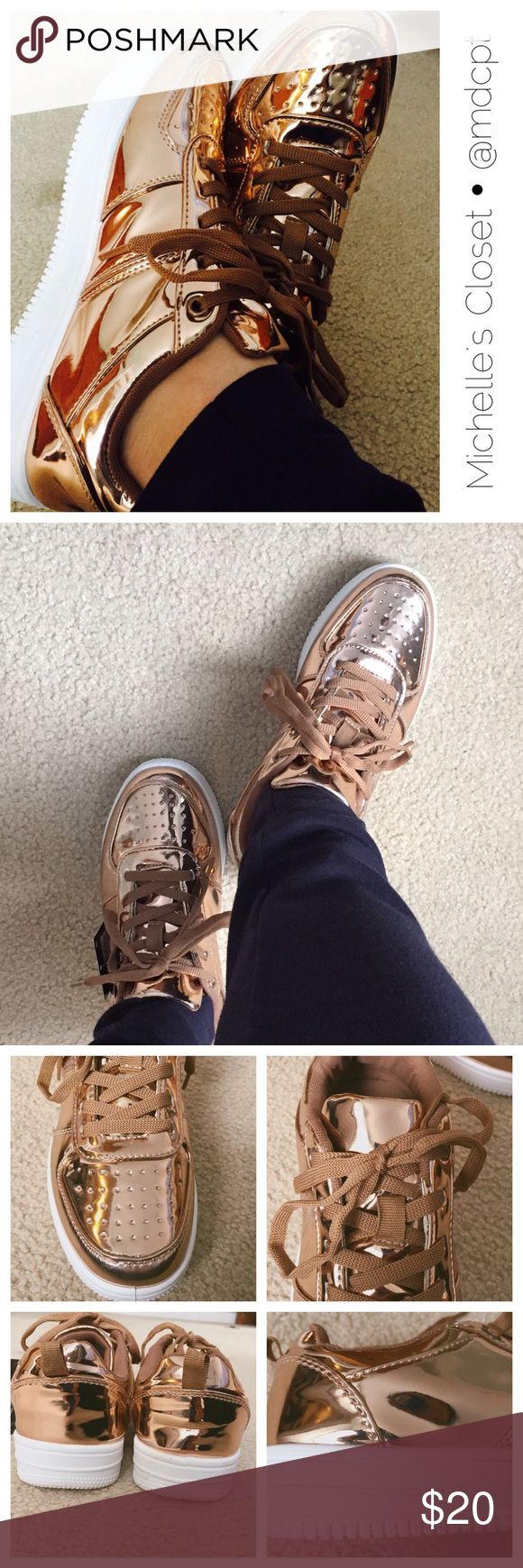Trendy Rose Gold Sneakers Comfortable casual athletic looking shoe, man made material.  Mirror rose gold outer, brown laces, white soles.  Run big as I usually wear size 7.5-8 and they were comfy on me. Atmosphere Shoes Athletic Shoes