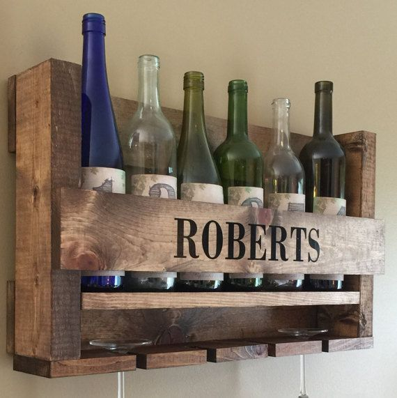 This personalized wine rack is the perfect addition to your home and makes for a very special wedding gift, housewarming gift or for other occasion! Each wine rack is individually handcrafted with quality boards and is personalized with your last name!  Wine Holder + Wine Glass Holder PERSONALIZED WITH LAST NAME  Dimensions - 23 wide x 14 tall x 5 deep  - Holds 6 Wine Bottles + 4 Wine Glasses - Thick Solid Wood - Beautiful Light Brown Rustic Stain - No Assembly Required - Hanging Material…