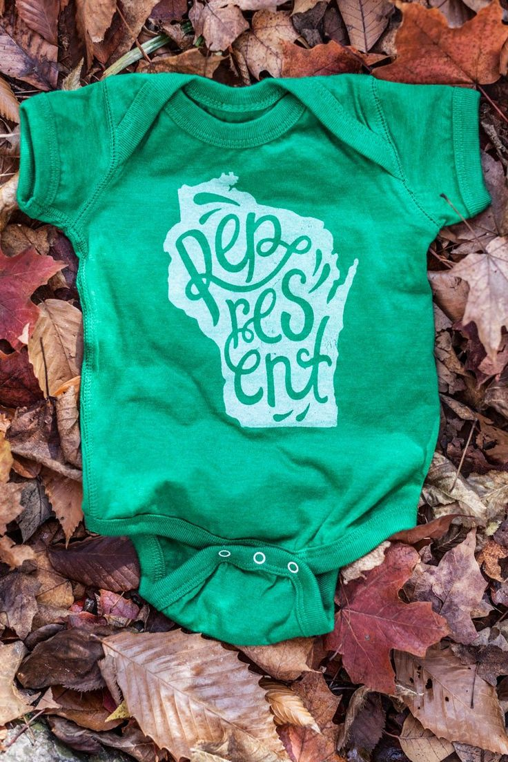 Represent Wisconsin Script Heather Green Baby Onesie