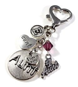 """Perfect gift for your #1 Aunt ! Speaking from experience, Aunts LOVE to display the pride of our special nieces & nephews.  Your Aunt will be overjoyed with this gorgeous key chain or purse charm, handmade & customized with your Aunts Initial & Swarovski Birthstone Crystal.  You may add a Cross or Star of David at no additional charge.  This handmade dangle is approximately 2.5"""" from end to end."""