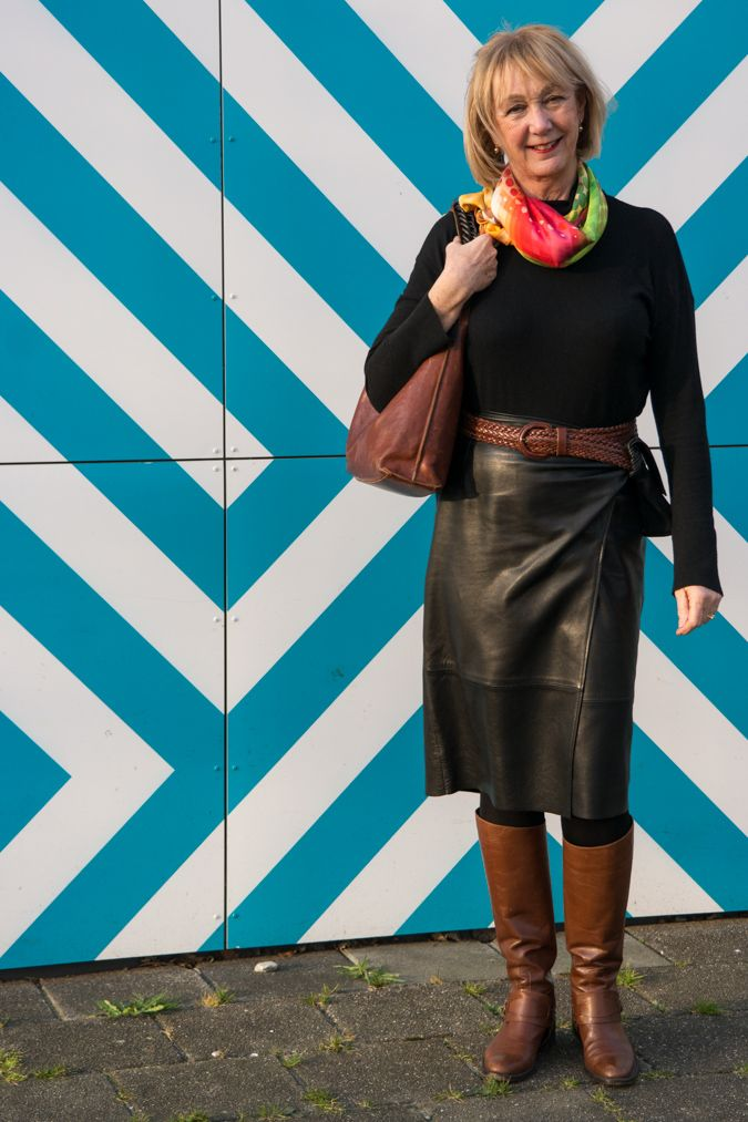 Black leather wrap skirt, tan boots (flat), tan bag and tan belt, black cashmere turtle neck.