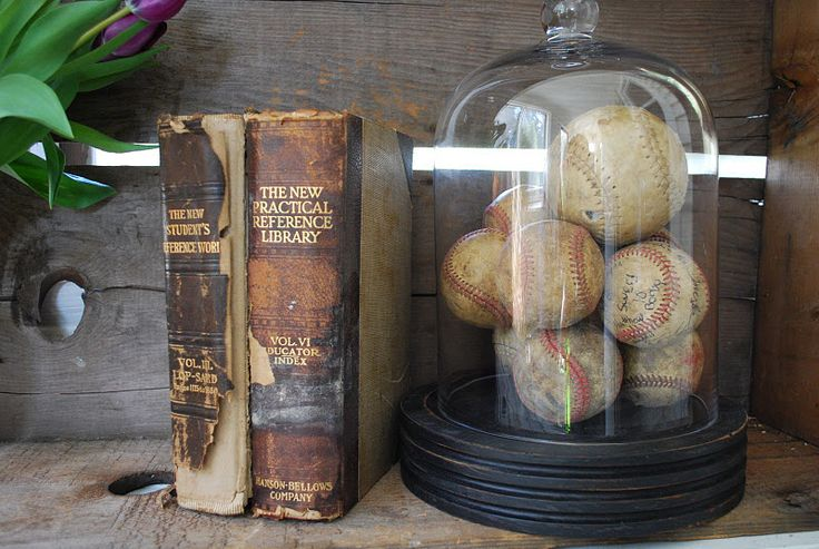 Love the old baseballs under glass for a man's study or a boy's room.  Always love old books.