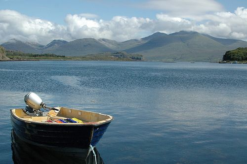 Ulva - Isle of Mull - Scotland  Boat off Ulva jetty and view to Ben More and Loch Na Keal