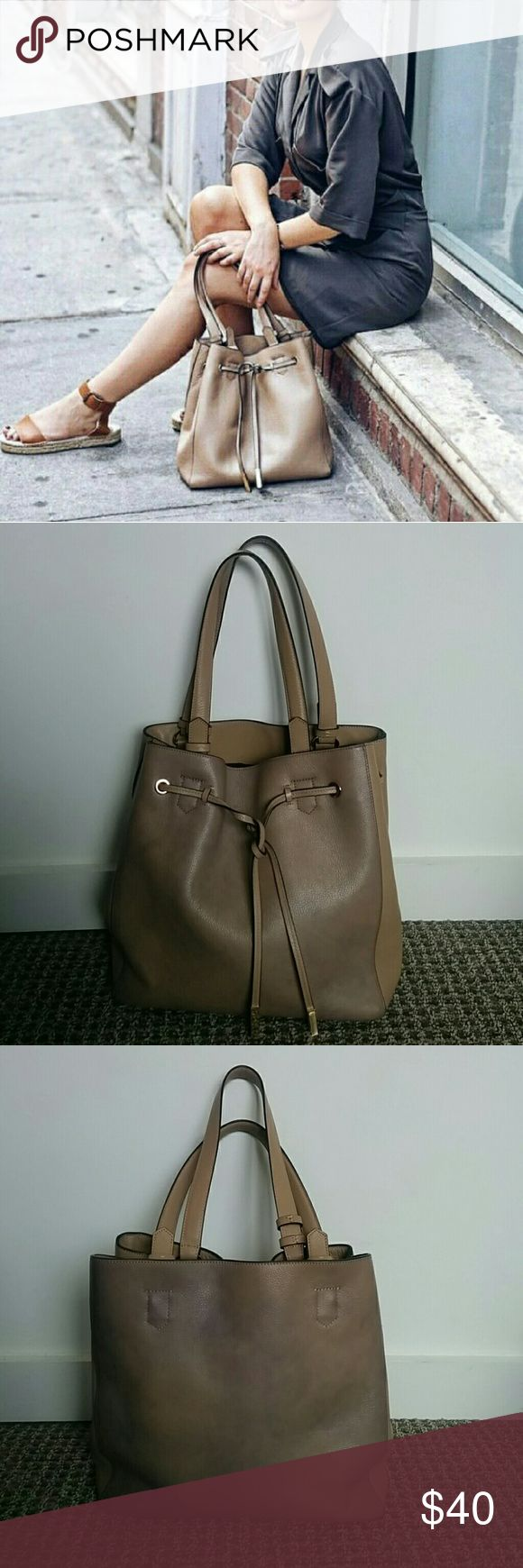 Reiss cream tote Soft supple leather tote in a beige leather. There is some color staining of the front and back of the bag from denim. The marbling gives it an interesting texture. Price reflects the staining. Reiss Bags Shoulder Bags