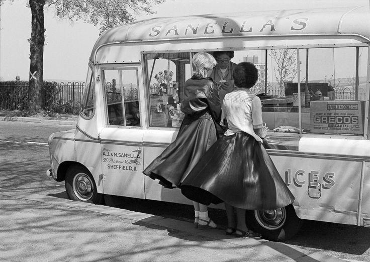 Girls buying ice cream Sheffield Crookes Valley park UK 1970s