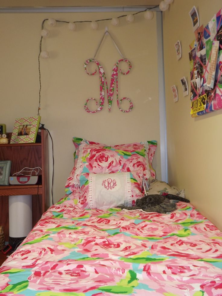 Morgan's dorm in Lilly Pulitzer bed ensemble, initial mod podged in old agenda pages, and bulletin board covered in old Lilly dress.
