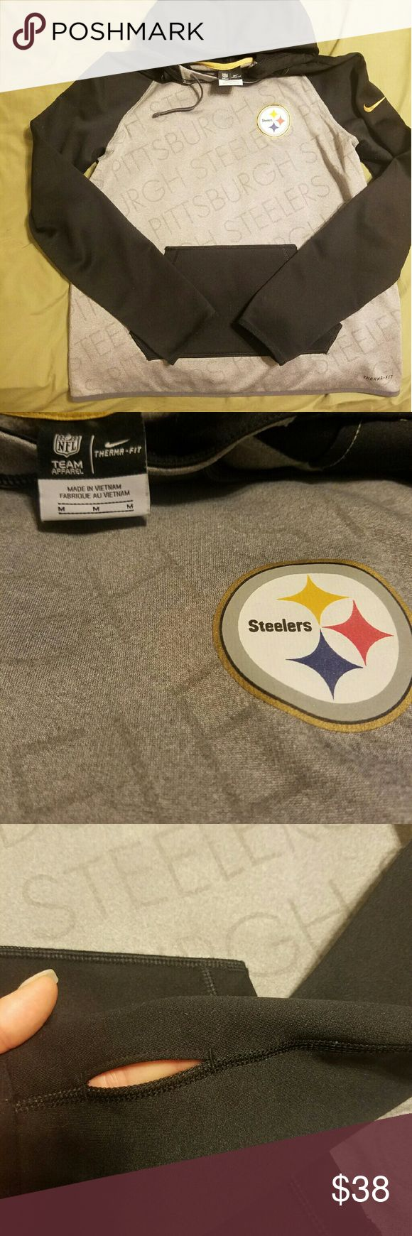 Women's Nike Sweatshirt This Nike Women's Steelers sweatshirt has thumb holes and worn only once to a game last November. Thermo fit for warmth in the winters without the bulkiness. Nike Tops Sweatshirts & Hoodies