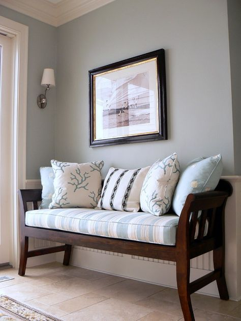 Sleepy Blue by Sherwin Williams. Love it in this entryway or foyer with the wood bench.