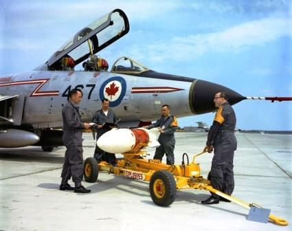 Image from http://silverhawkauthor.com/images/site_graphics/Aviation/Libarary__Archives_Canada/McDonnell_CF-101B_Voodoo_with_Genie_missile_being_loaded._LAC_MIKAN_No._4104845.jpg.