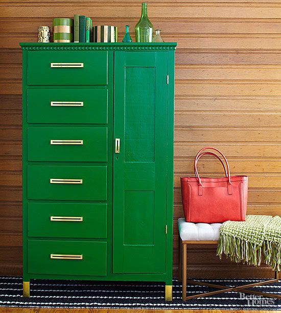 Unusual colors are easy to accept when used on pieces of furniture rather than entire lengths of drywall or plaster. Here, an unassuming armoire is given magnificent character just by painting it a rich emerald color and by adding a few thoughtfully placed gold details. The Color: Derbyshire, SW6741 -- Sherwin-Williams