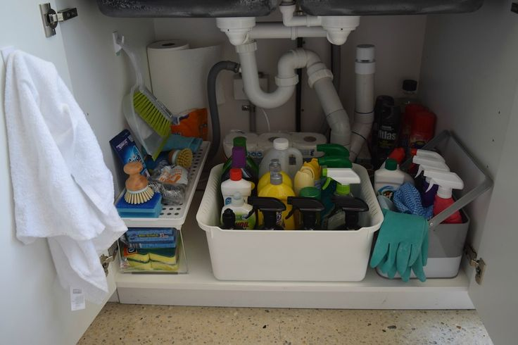 AFTER: my kitchen sink was a total mess and space was being wasted. Using smart storage solutions and hooks, I've maximised every corner of space under my kitchen sink.