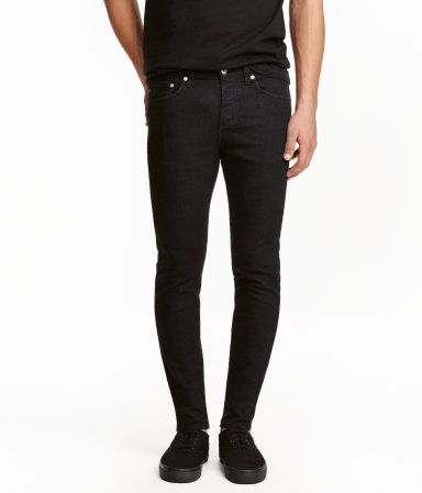 Black denim. 5-pocket, low-rise jeans in washed stretch denim with a button fly and skinny legs.