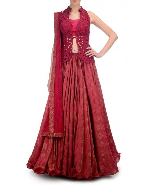 Rose red brocade Lehenga with hand woven designs. This set includes a matching sleeveless jacket blouse with floral cut work applique. Band collar. Wash Care: Dry clean onlyMatching bustier and dupatta included