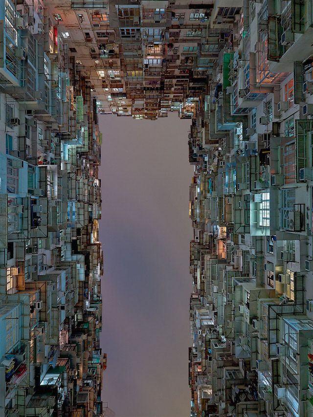 During a travel in Hong Kong, photographer Hans Wilschut has captured low-angle shot buildings images from a courtyard.