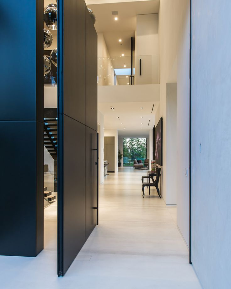 Check out the giant panel door in this Beverly Grove Residence (in Beverly…