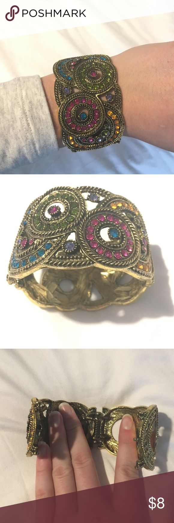 Multicolored rhinestone hinged bracelet Hinge is spring loaded. Missing one unnoticeable turquoise rhinestone. Jewelry Bracelets