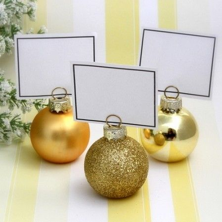 our gold bauble place card holders are perfect for a yuletide wedding or even round