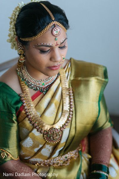 South Indian bride. Temple jewelry. Green and gold silk kanchipuram sari. Braid with fresh flowers. Tamil bride. Telugu bride. Kannada bride. Hindu bride. Malayalee bride.