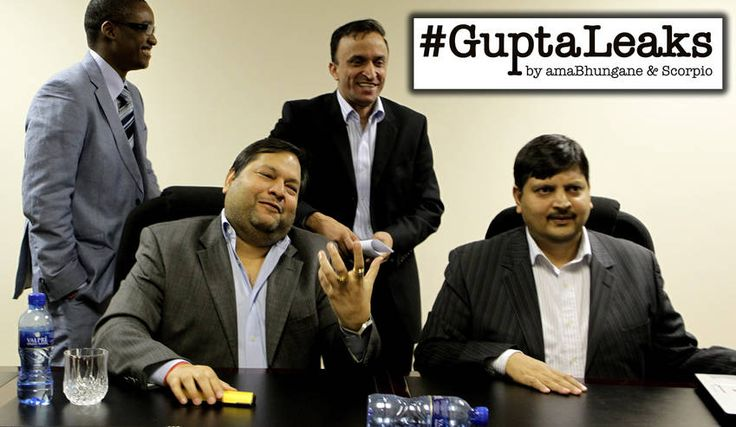 Photo: Ajay and Atul Gupta, Duduzane Zuma and Jagdish Parekh (standing) speak to the City Press from the New Age Newspaper's offices in Midrand, Johannesburg, South Africa on 4 March 2011. (Photo by Gallo Images/City Press/Muntu Vilakazi)