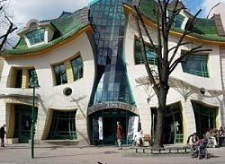 """The Crooked House. Sopot, Poland.     The facade has a vaguely human face to it and evokes the imagery of Munch's painting """"The Scream"""". The building looks like it is melting in the midday sun and is one of the most photographed buildings in Poland. Inside the building are a variety of bars and restaurants which disappointingly don't heavily reflect the style that the exterior boldly promises."""