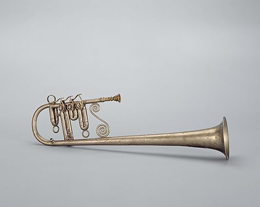 Over-the-Shoulder Soprano Horn in E-flat Bell over-the-shoulder instruments were often used in American brass bands between about 1840 and 1890. They were built in families, from soprano in E-flat, like this instrument, to a bass horn.