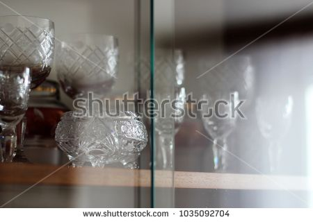 Soviet wall furniture - cups and glasses at display.