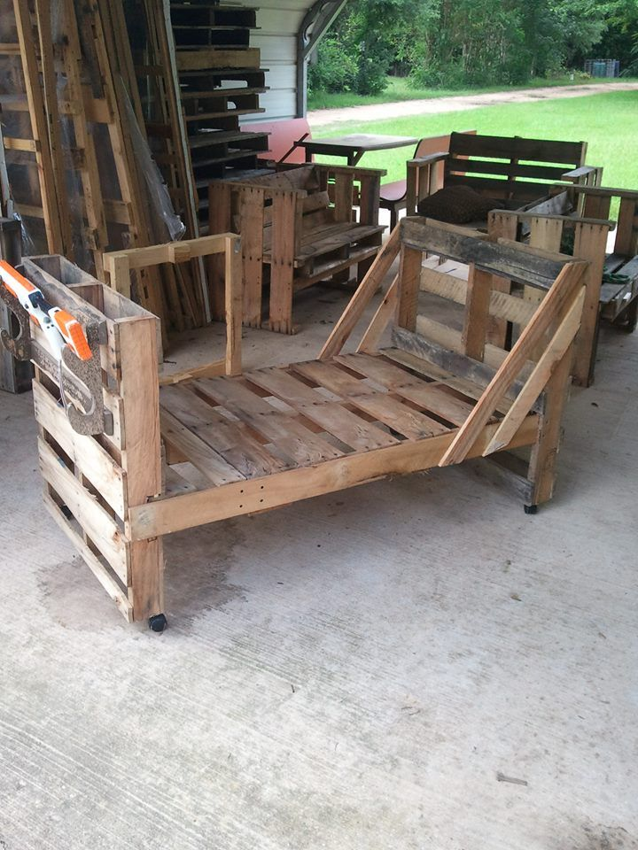Pallet toddler bed complete with BB gun rack and four toy trays.