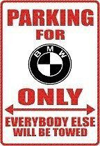"""Here is a PARKING SIGN for yourself or your favorite BMW driver! We can also CUSTOMIZE any saying/sign you want. Sign is 12"""" x 18"""" baked WHITE aluminum with DURABLE VINYL RED lettering and BLACK logo."""