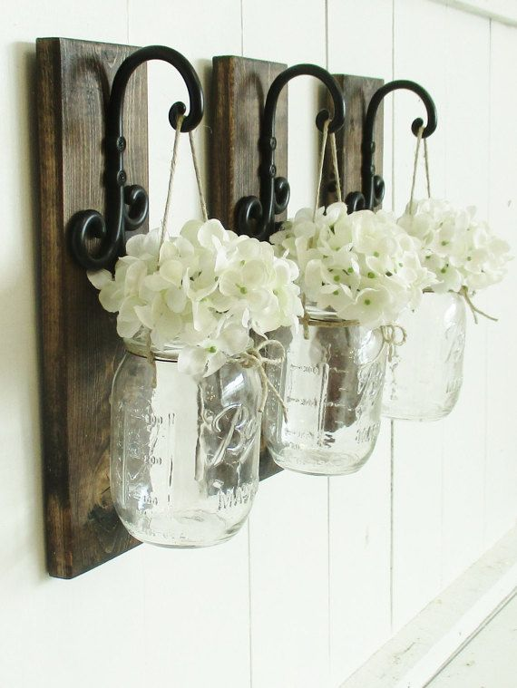 ***THIS IS FOR A SET OF 3 MASON JAR WALL DECOR....  ~~~~~Hydrangeas are now available and can with added to your order from pull down menu. They are a cream/white with green little centers.  The flowers have soft petite petals.....   I will no longer be offering my rustic wall decor in the 11 x 5.5 boards.  These boards are  perfectly imperfect  with lots of rustic character. Some may have knot holes, cracks, holes etc.... No 2 are them same.  These are stained in a special custom stain…