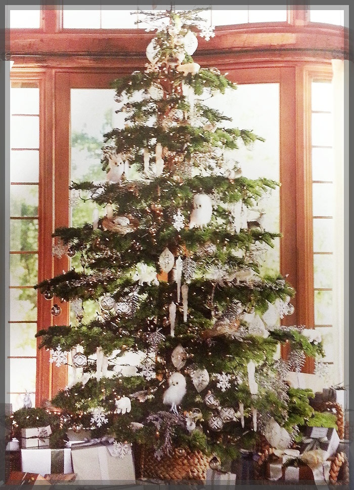 This gorgeous Christmas tree has a unique-yet-simple design to it that we just love. Notice how the decorations favorably match the color tones of the room. Whites, natural wood colors, and simple accents make this Christmas tree blend perfectly with its surroundings.        See our favorite artificial Christmas trees this holiday at Treetime's website.