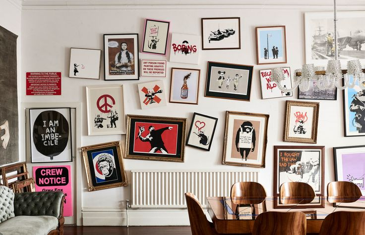 Sandra Powell and Andrew King's impressive Banksy wall! Art deco Australian table and chairs. Photo – Eve Wilson. Production – Lucy Feagins / The Design Files.