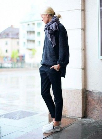 Stand out among other stylish civilians in a dark grey oversized sweater and black suit pants. Want to go easy on the shoe front? Go for a pair of grey slip-on sneakers for the day.