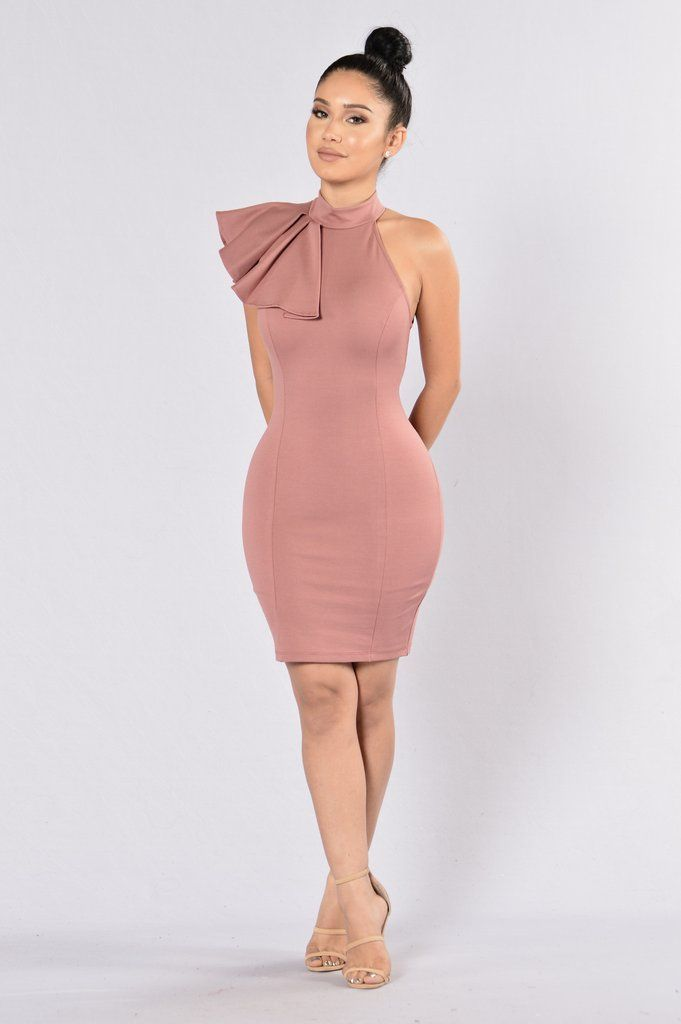 - Available in Cognac, Hunter Green, Mauve, Wine, Red, and Black - Fitted Dress - Nylon Ponte - Ruffle Detail - Mock Neckline - Sleeveless - Knee Length - Made in USA - 65% Rayon 30% Nylon 5% Spandex