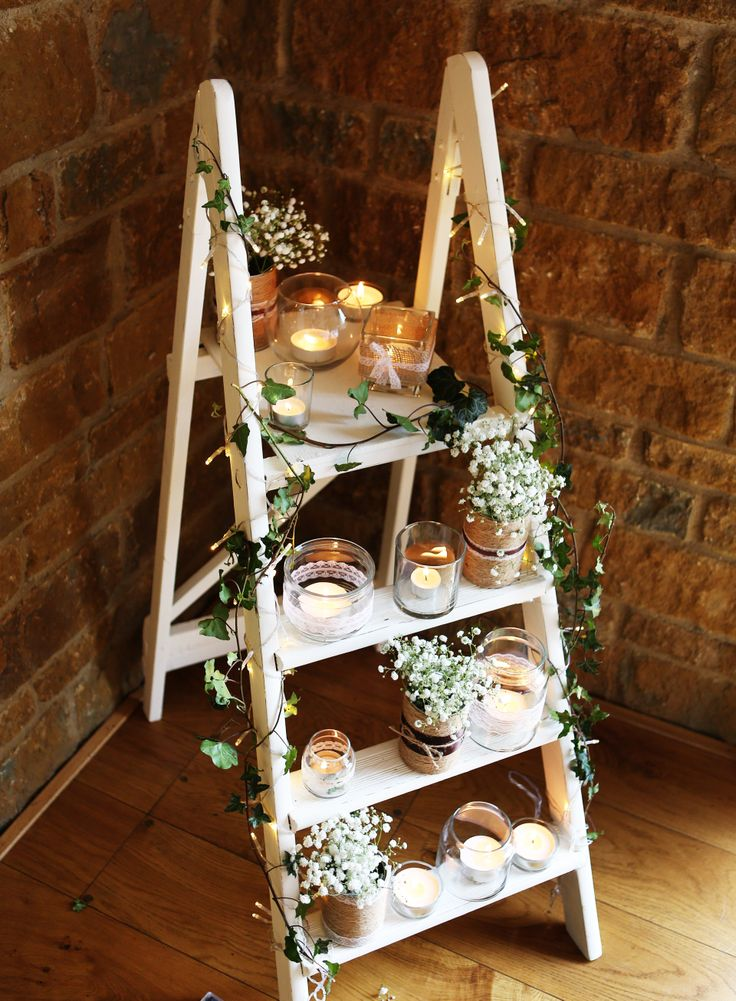 Rustic wedding, painted ladder, candles, flowers
