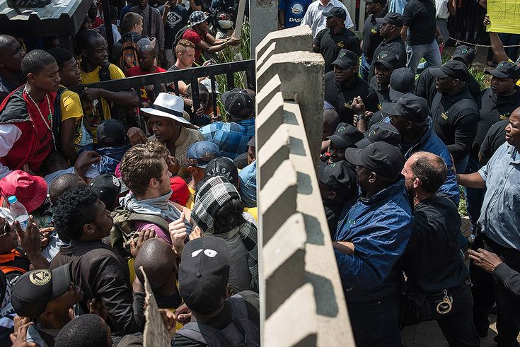 University of Johannesburg students attempt to enter the campus during a protest against fee hikes #Feesmustfall
