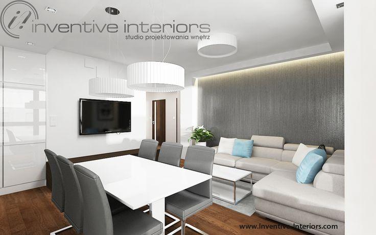 Projekt salonu Inventive Interiors - beżowy narożnik na tle szarej tapety salonie