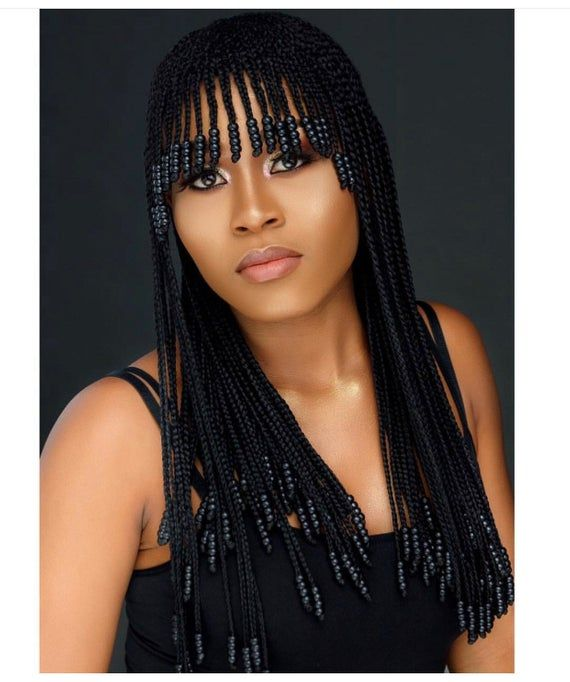 Braided wig with bangs and beads.Neatly and tightly done.The length in the picture is 22″ long. It's