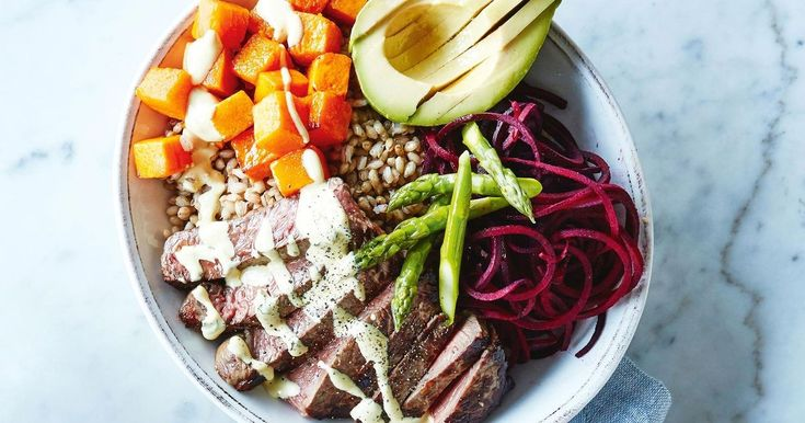 Drizzle Moroccan-style yoghurt dressing over this quick and easy beef and pearly barley salad bowl.