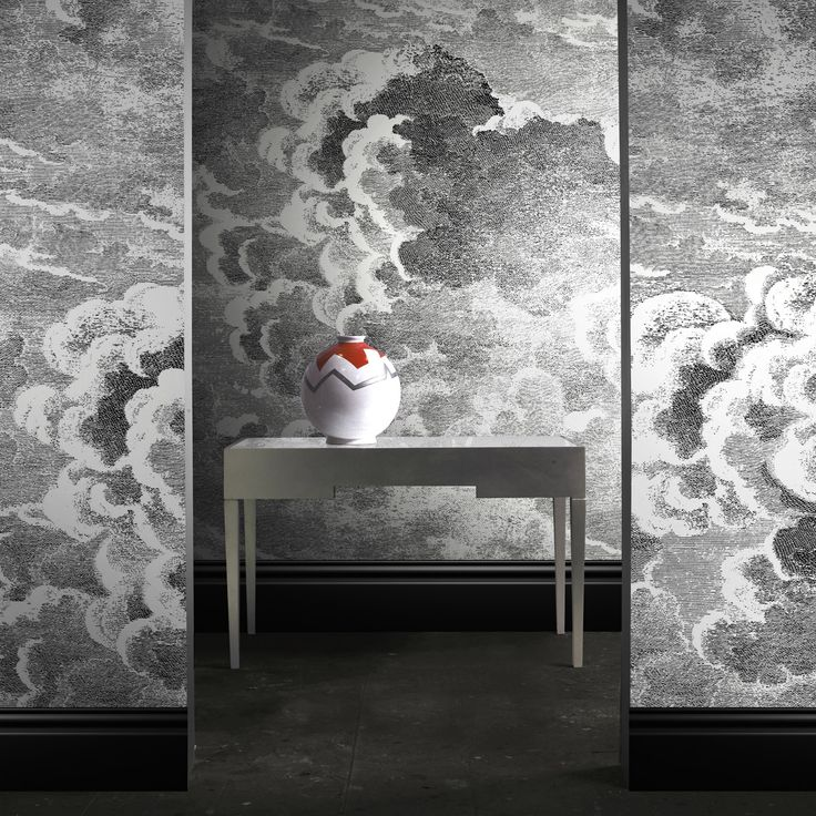 Fornasetti Nuvole wallpaper by Cole & Son. Drama on a wall!