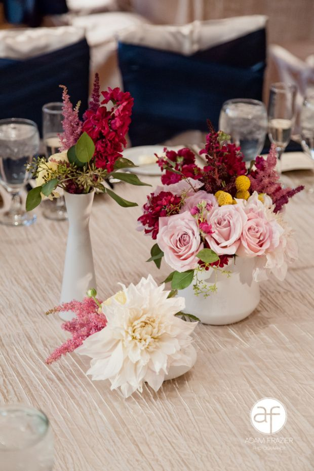 wedding-low-centerpiece from Enchanted Florist Las Vegas Wedding Florist  - pale pink flowers with pops of burgundy and yellow